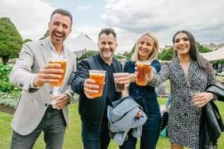 May be an image of 4 people, drink and outdoors