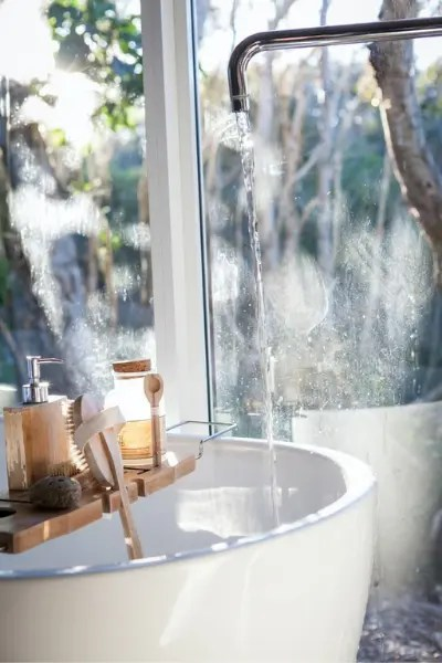 white ceramic sink next to a window
