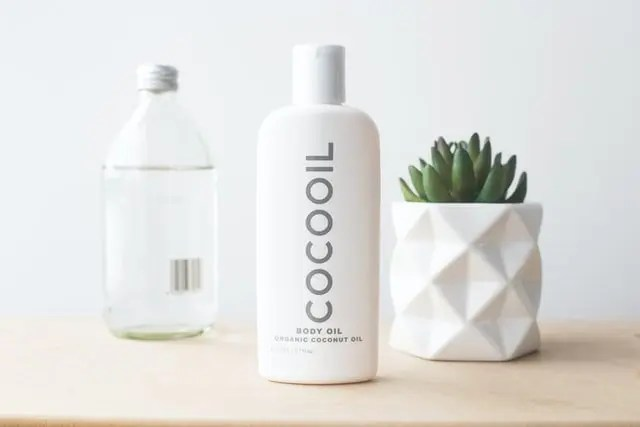 Cocooil organic body oil on a desk