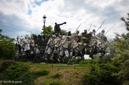 A surprisingly artistic monument; it's meant to show the conversion of the useless bourgeoise (the dandies to the left) into a lean, mean (or at least starved and oppressed) army of communism.