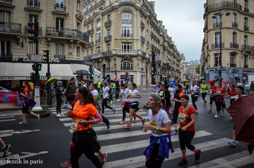 Runners running.