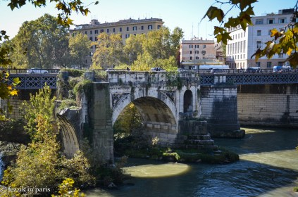 """Ponte Rotto, which is in the middle of nowhere. Fortunately, the Purrito understands that when I say """"it's an old Roman bridge"""" what I'm really saying is """"I'm going to cry when we get home if I don't see it."""" So, we saw it. (It's the oldest extant bridge in Rome! 2nd century BCE! Roman engineers really overdesigned everything)"""