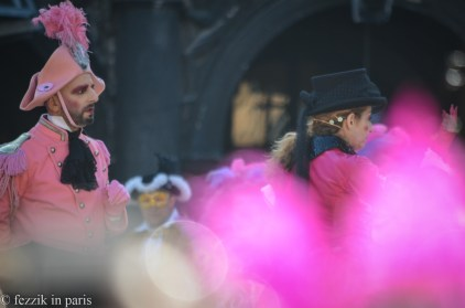 A woman with a mess of pink feathers on her head stepped in front of me; the pink blob adds to the picture, in my opinion.