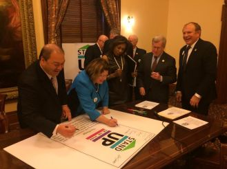 Sen. Linda Greenstein (center in blue) signs the Pledge