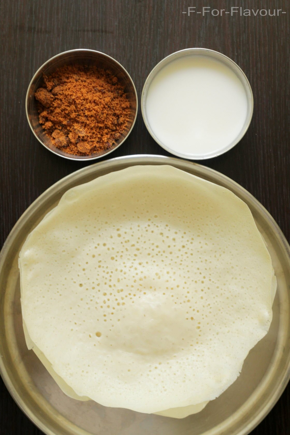 appam served with coconut milk and brown sugar
