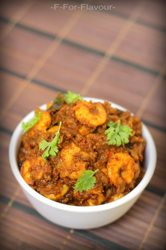 Prawn Ghee Roast garnished with coriander leaves