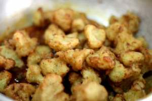 add fried cauliflower florets to the sauce