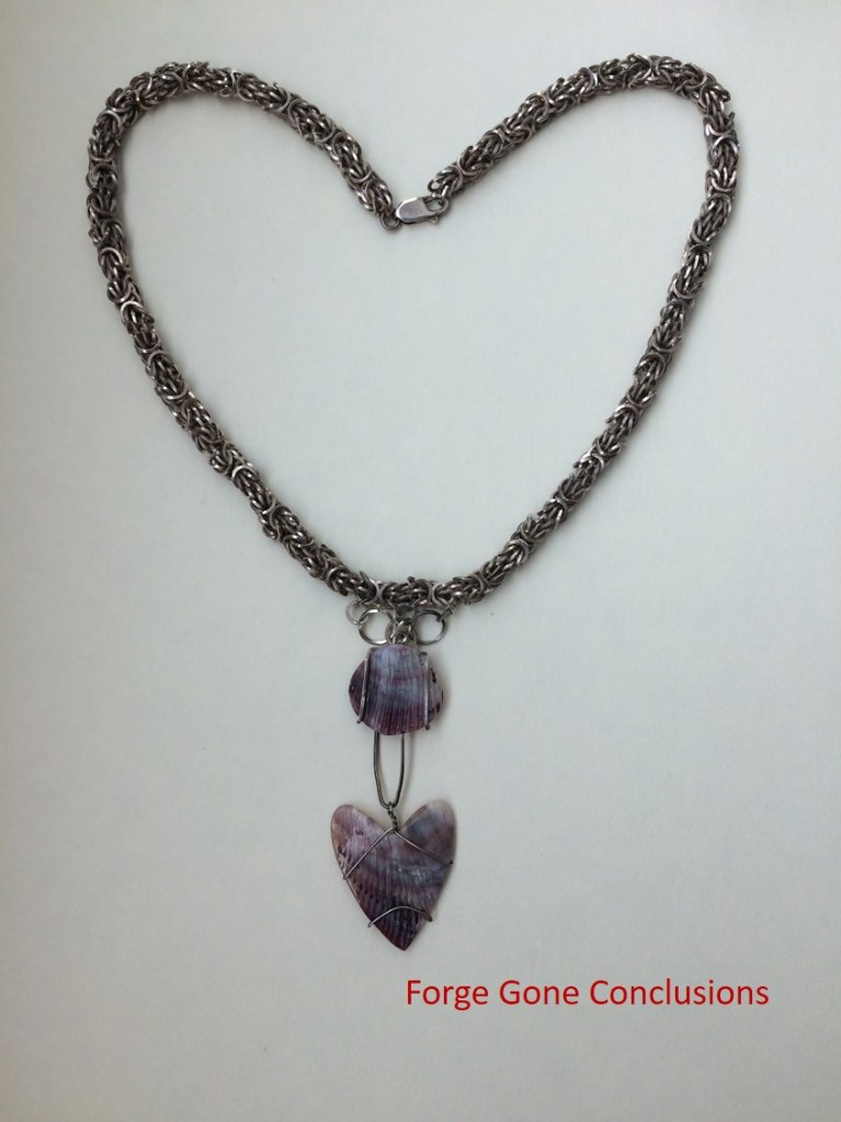 About us at Forge Gone Conclusions- picture of a handmade necklace with seashells