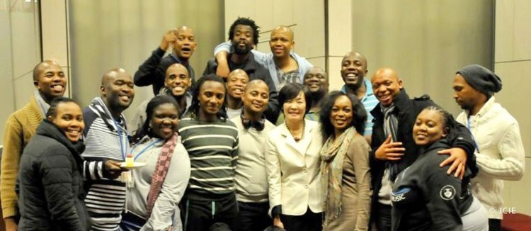 First Lady Akie Abe with members of the Isango Ensemble