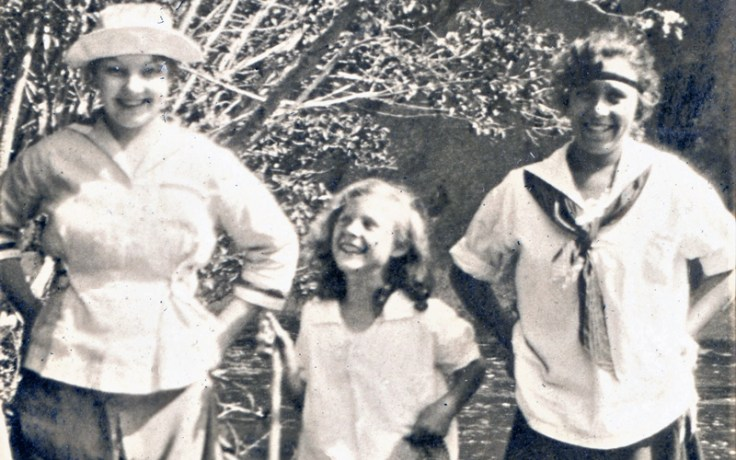 Three girls in the 1920s outside