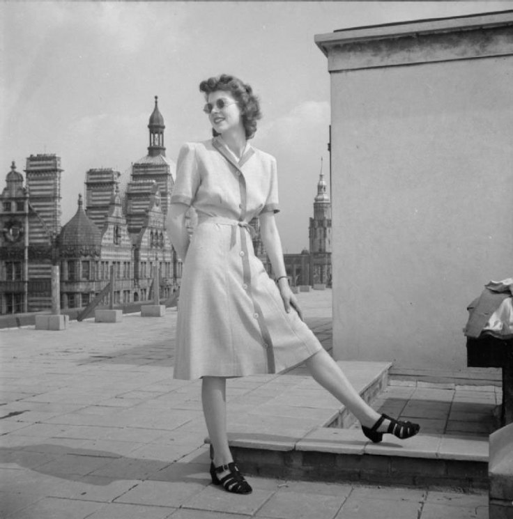 Woman wearing 1940s fashion dress