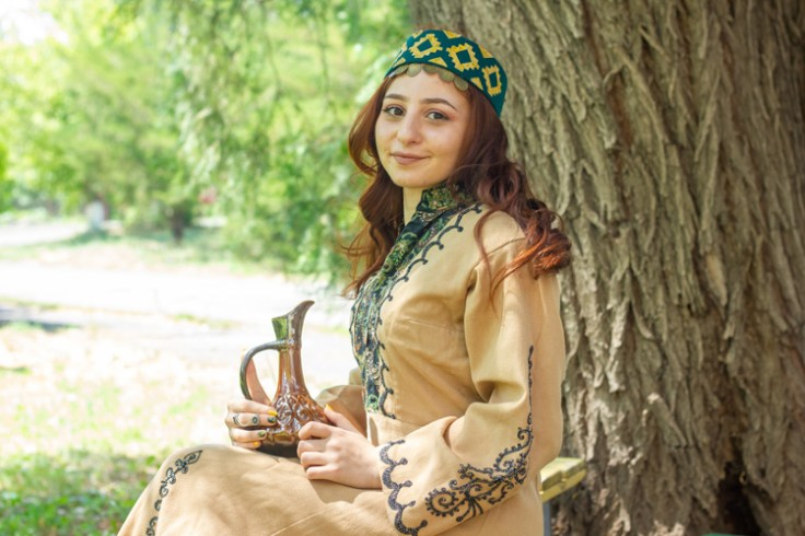 a girl in traditional armenian clothing