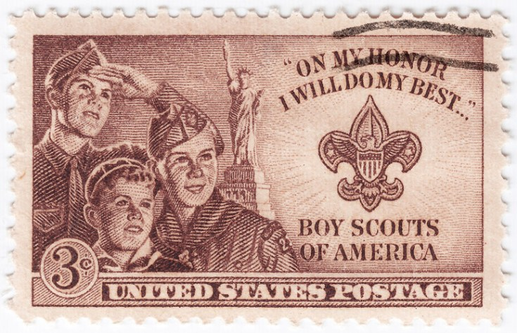 the boy scouts of america logo on a stamp, which has a fleur de lis on it.