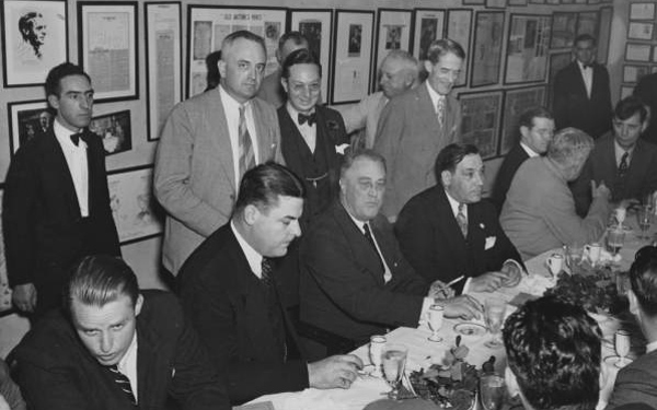A group of WPA organizers plan the New Deal.