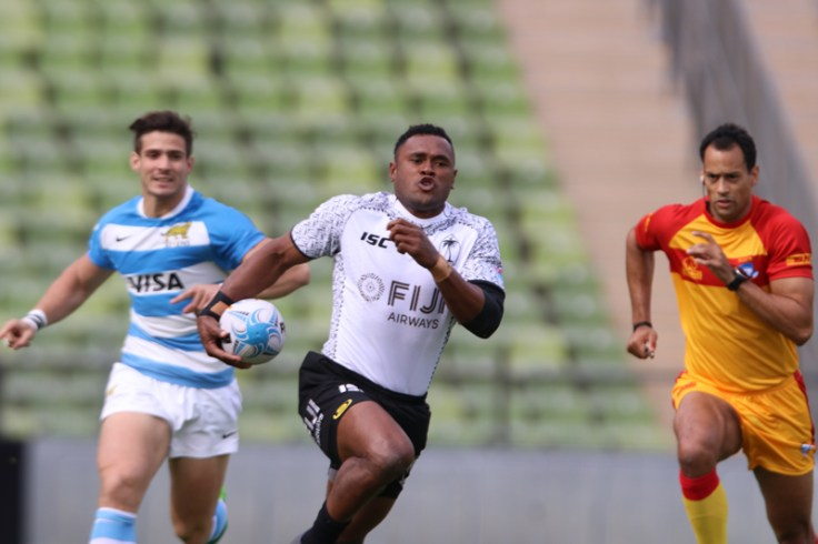 Fijian rugby team playing on field
