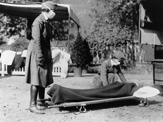 Nurses train and treat pandemic victims.