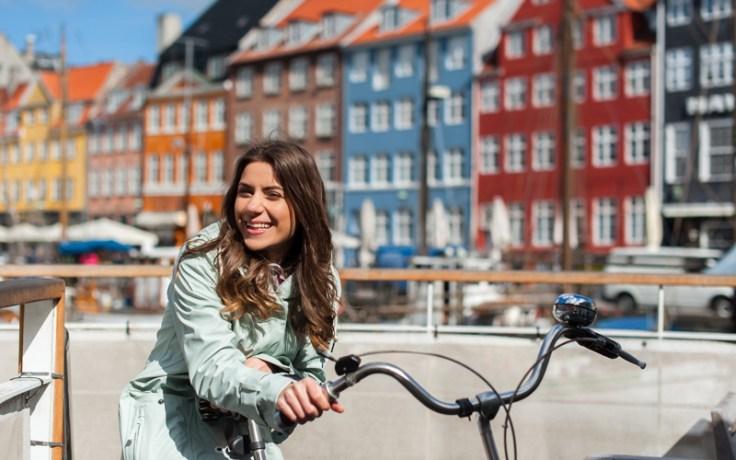 Girl on bike in Nyhavn