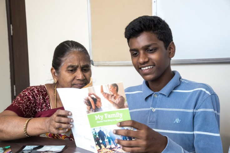 a woman and her son use the my family booklet