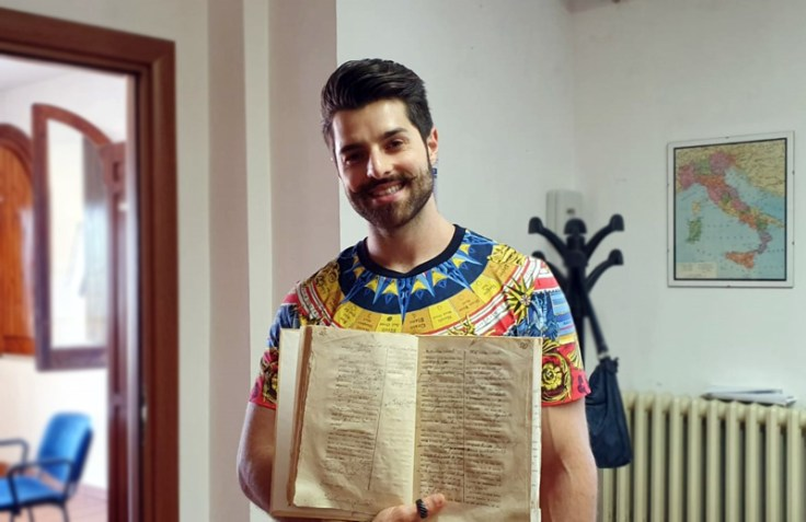 Alok holding an Italian record from his ancestors.
