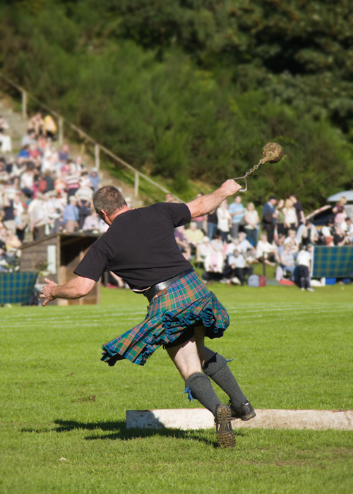 a man competes in the highland games.