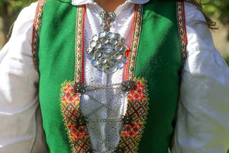 a modern bunad with traditional solje jewelry
