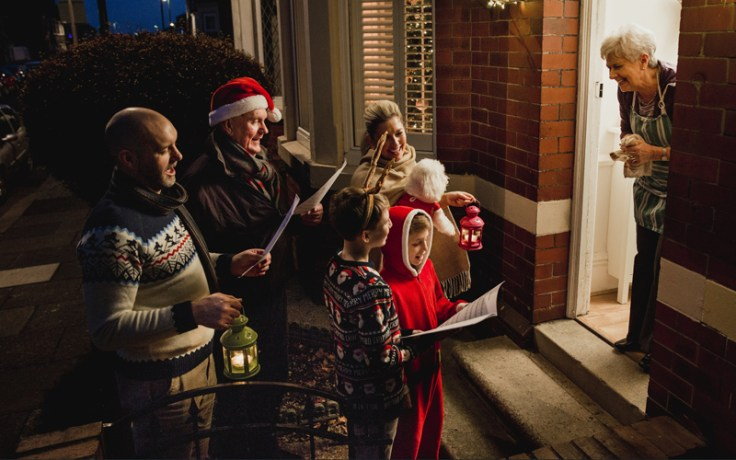 a group goes holiday caroling.