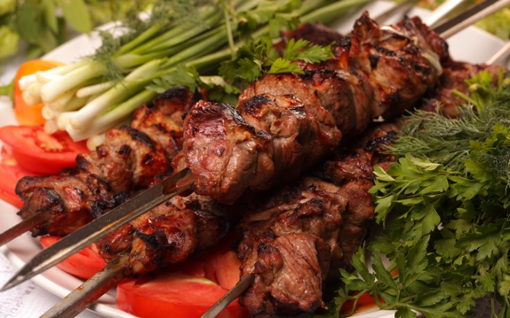 Brazilian churrasco, barbecue meat on skewers.