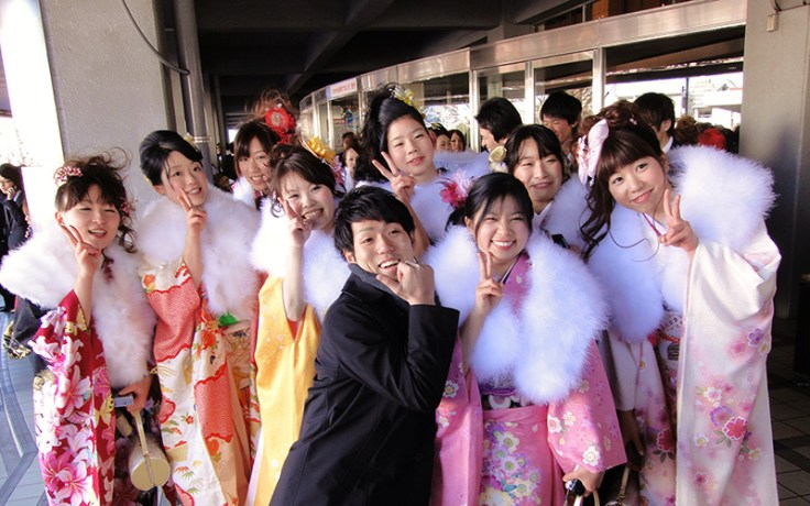 several japanese young adults at coming of age day, a japanese cultural celebration.