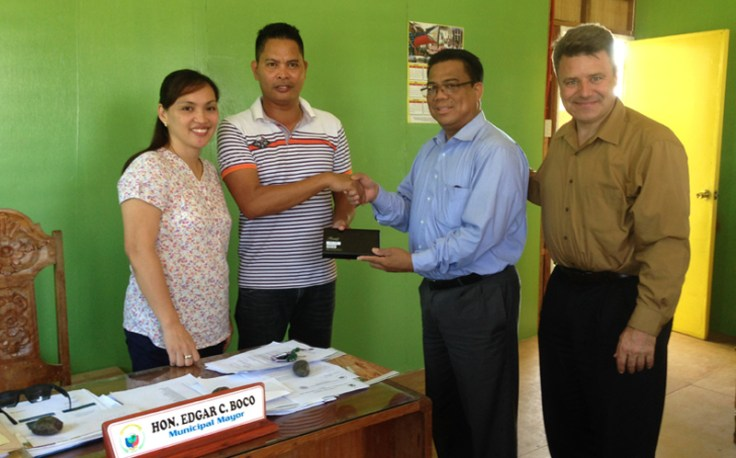 Derek Dobson in the Philippines with Charito C Aberia, the local registrar, Hon. Edgar C Boco, the municipal mayor of Hernani, Eastern Samar, Philippines, and Manolito Baul, Country Manager Philippines for FamilySearch.