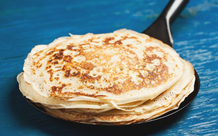 english pancakes on a cast-iron skillet.