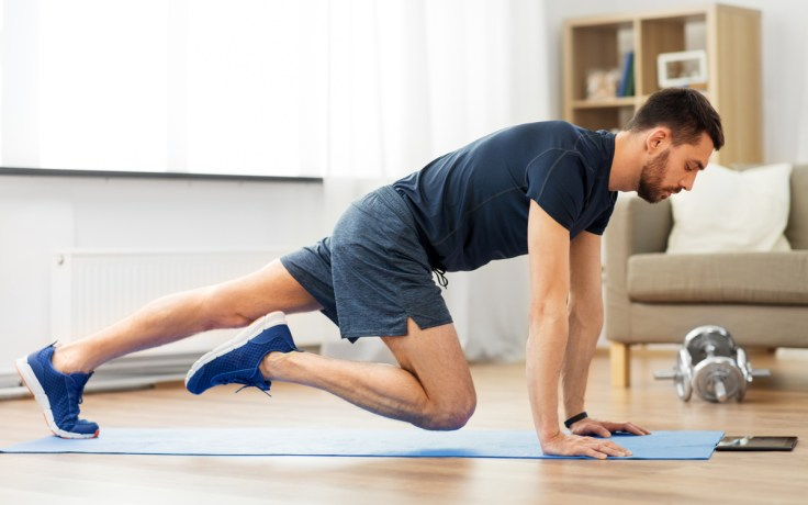 a man is productive by exercising at home