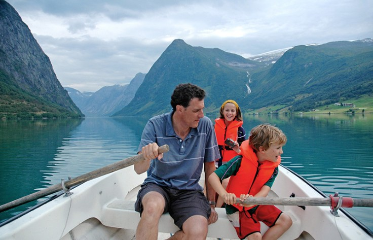 a family goes boating in norway.