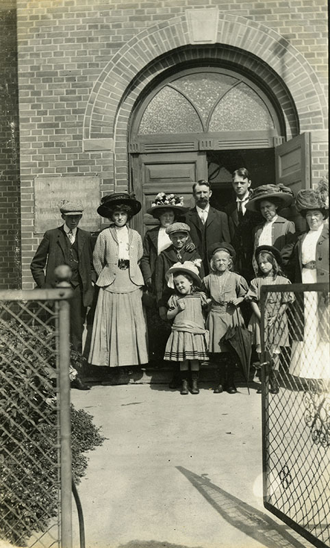 a family outside of a church building.