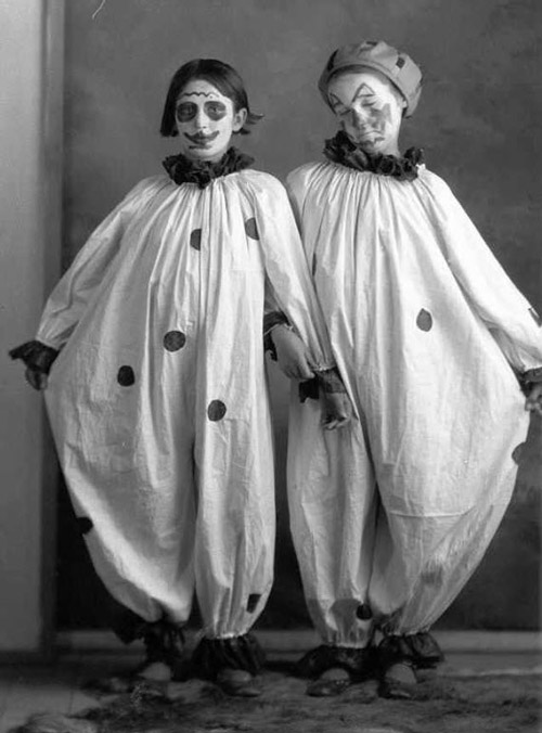 Little girls in clown costumes, old photo.