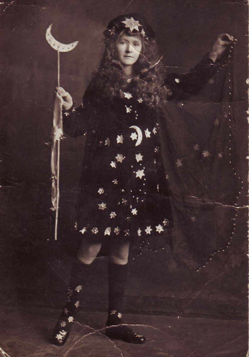 Old photo of girl dressed as Night for Halloween.