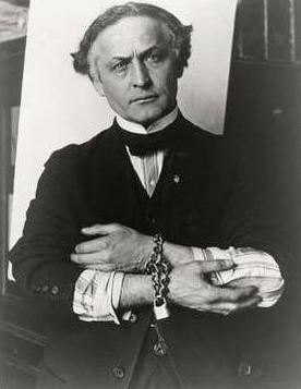 Harry Houdini with bound hands