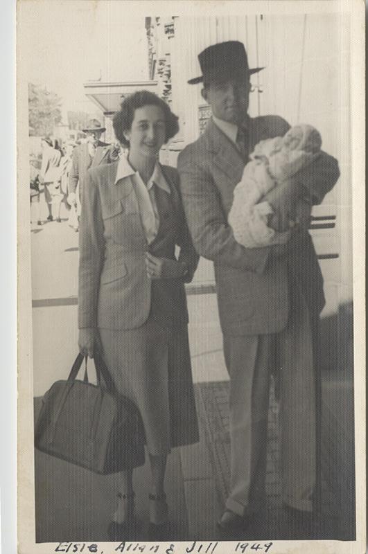 Jill's parents holding her as a newborn.