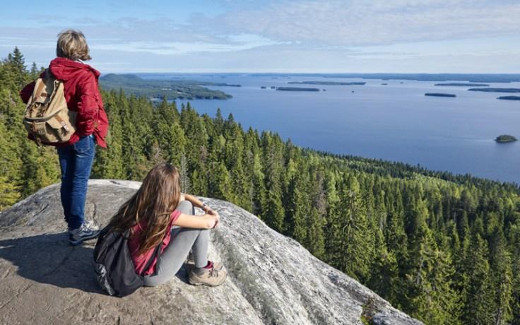 Koli National Park. Woman and girl sitting on rock