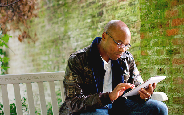 A man researches on his ipad.