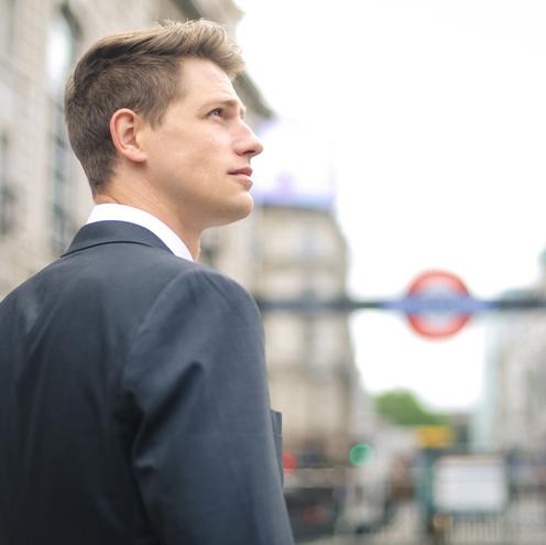 A man walks down a street in London
