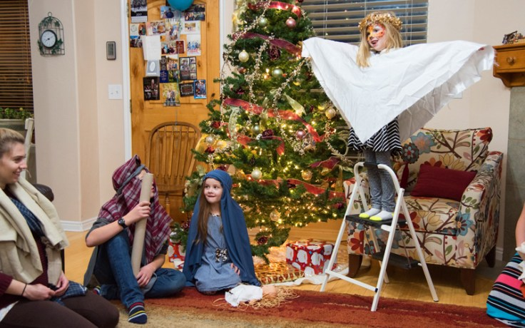 a family reenacts a holiday story.