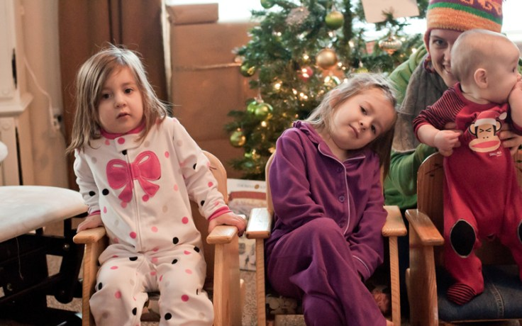 two girls celebrate pajama day, a holiday tradition held by a family.