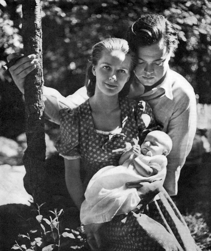 silent generation husband and wife holding baby