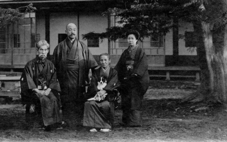 a historic photo of a japanese family.