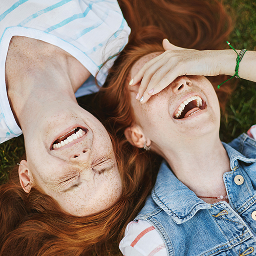 Twin girls laughing.