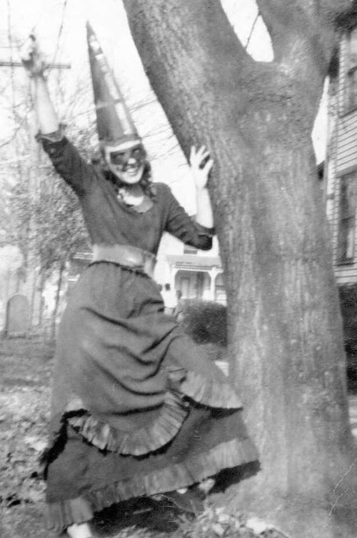 Young woman excited for Halloween in 1946.