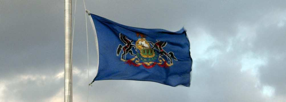 The state flag of Pennsylvania flying at the state capitol building.