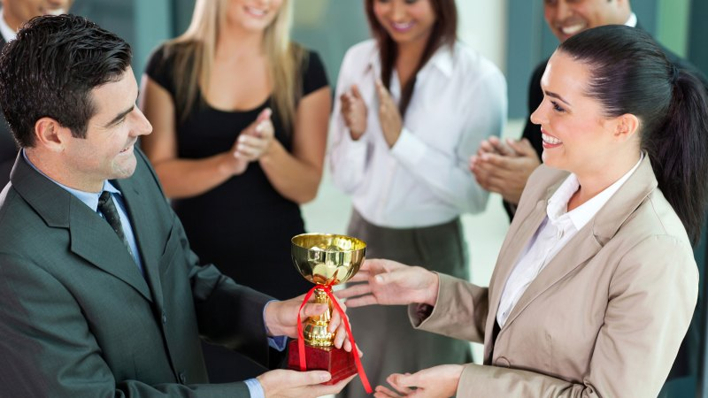 Woman receiving an award at work