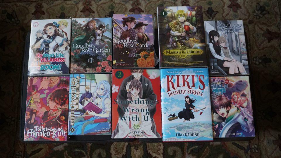 Photo of ten books purchased from Kinokuniya.