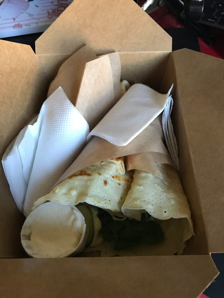 Photo of crepes in a to-go box.
